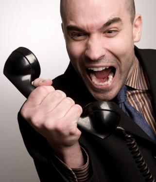 man-screaming-on-phone
